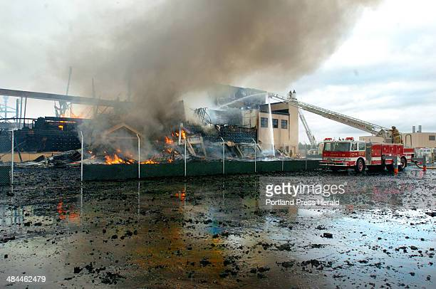Staff photo by Doug Jones Wednesday June 13 2007 Hanger burned at NAS Brunswick bringing in mutual aid from Brunswick Bath Lisbon Topsham and...