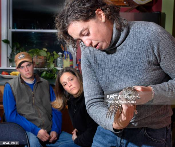 Wednesday October 16 2007 Wildlife biologist Judy Camuso discusses the wings of a recently captured Northern Sawwhet Owl while Forrest Malesky and...