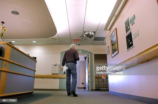 Staff Photo by Fred Field Portland Maine Jack Gibson walks the Gibson cancer ward at Maine Medical Center Sunday in search of cancer patients iwho...