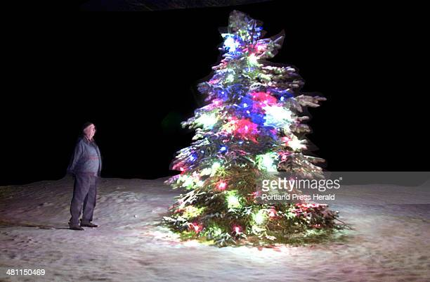 Staff Photo by Fred J Field Tuesday December 18 2001 World War II Navy Veteran Granville Johnson of Bailey Island is bathed in the glow of his...