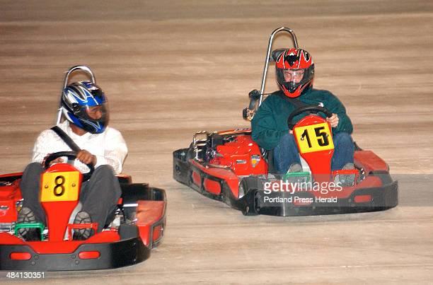 Staff Photo by Gordon Chibroski Friday November 21 2003 Press Herald reporter Justin Ellis has an edge on GoKart racing track owner Rick Snow during...