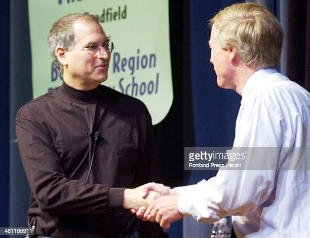 Staff Photo by Gordon Chibroski Monday June 10 2002 Steve Jobs founder and president of Apple Computer is greeted by Governor Angus King as he is...