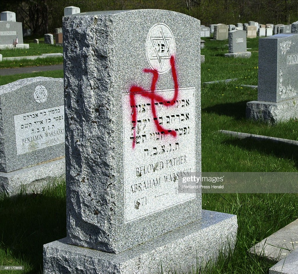 Staff Photo by Gordon Chibroski Monday May 7 2001 Antisemitic symbols were painted on some of the headstones in Mt Sinai Cemetery in Portland by...