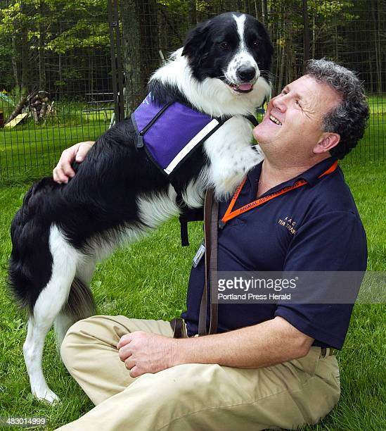 Staff Photo by Gordon Chibroski Thursday August 19 2004 Bobbie a Border Collie and his master George Quinlan who are Maine's first crisis response...