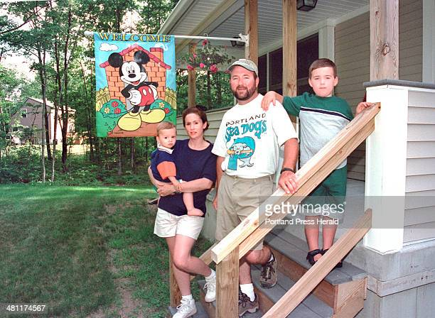 Staff Photo by Gordon Chibroski Thursday July 13 2000 Linda and Michael Mitchell stand on their front steps of their home in the Cooks Brook...