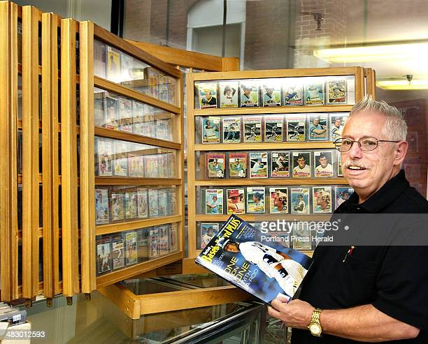 Staff Photo by Gordon Chibroski Tuesday August 31 2004 Edd Cabral owner of Triple Play Sports Cards at 907 Main Street in Westbrook has over 400...