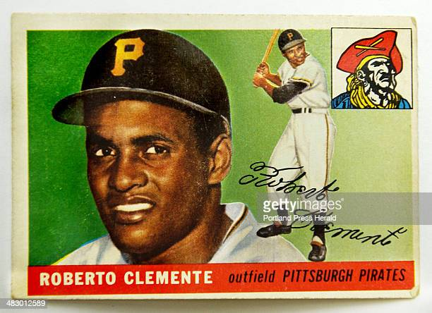Staff Photo by Gordon Chibroski Tuesday August 31 2004 This Roberto Clemente 1955 Topps card is one of the more expensive cards in Edd Cabral's...