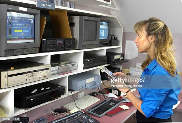 Staff Photo by Gordon Chibroski Tuesday May 30 2006 Judy Brown of ABBA Video Production in Gorham works with her video editing equipment in her...