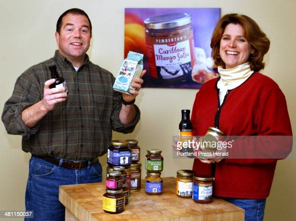Staff Photo by Gordon Chibroski Wednesday April 2 2003 Jeff and Sarah Johnson owners of Pemberton's Gourmet Foods in Gray show some of their...