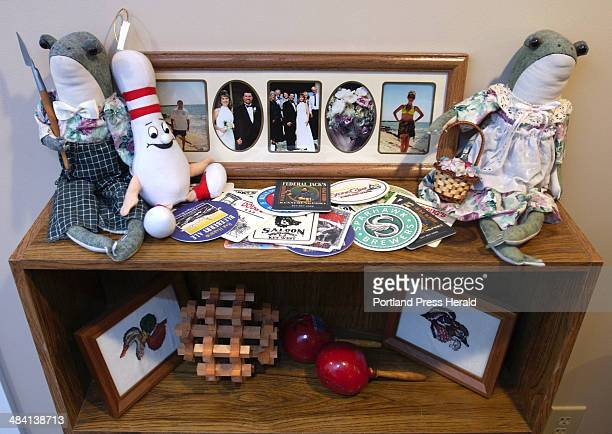 Staff Photo by Gordon Chibroski Wednesday December 29 2004 Family mementos found a home in the underused space in the basement playroom of the...