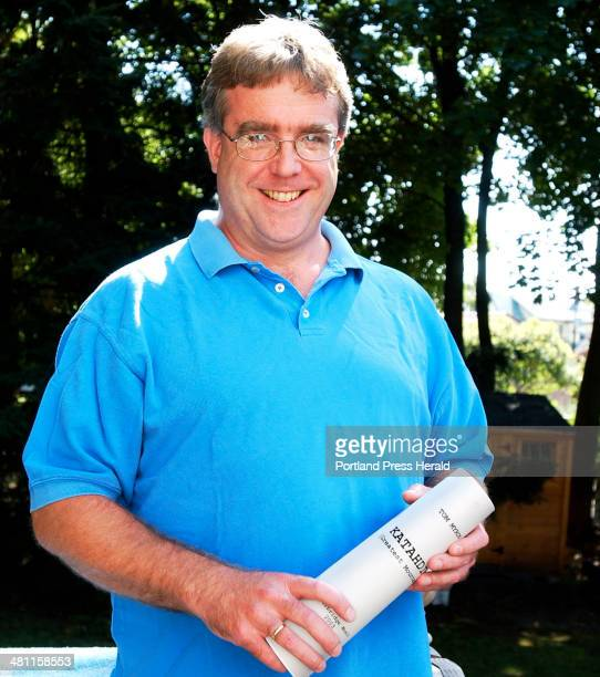 Staff Photo by Gordon Chibroski Wednesday September 10 2003 Tom Myron relaxes on his backyard deck as he holds a copy of his piece that will be...