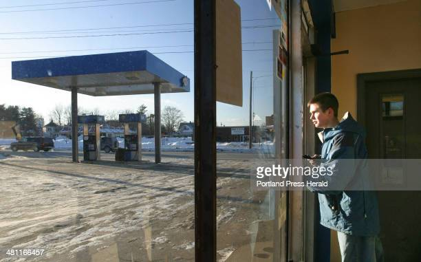 Staff Photo by Gregory Rec Fri Feb 14 2003 Tony Delcourt heads out the door to help a customer at Guay's Sunoco at Five Points intersection in...