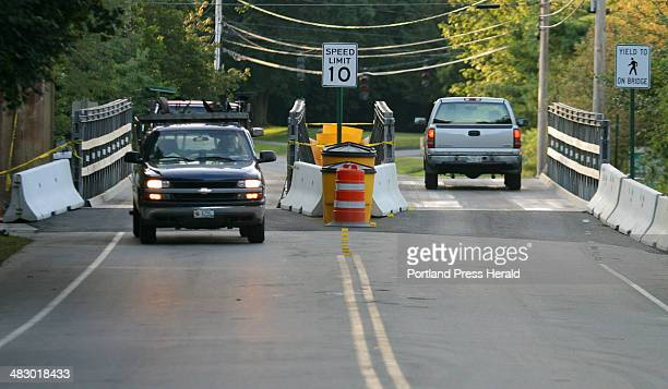 Staff Photo by Gregory Rec Friday August 6 2004 Trucks pass over the newlyopened temporary bridge on Summer Street in Kennebunk Friday morning The...