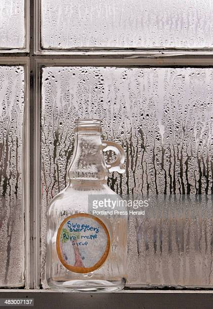 Staff photo by Gregory Rec Wednesday March 22 2006 An empty bottle of syrup sits on a widow sill in the sugar shack at Sweetser in Saco Staff and...