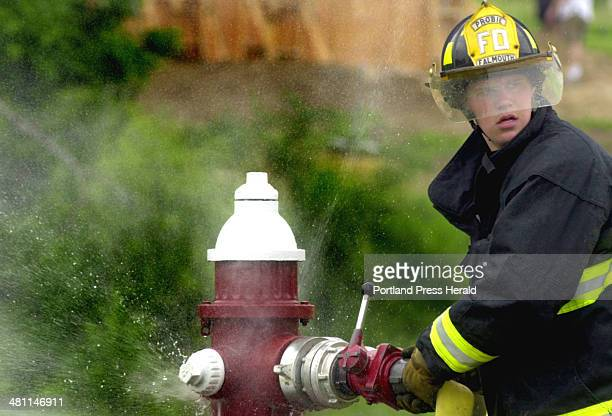 Staff Photo by Herb Swanson Sat Jun 22 2002 Kurt Knudsen of the Falmouth Fire Department's Engine 1 take part in the wet hose competition in the...