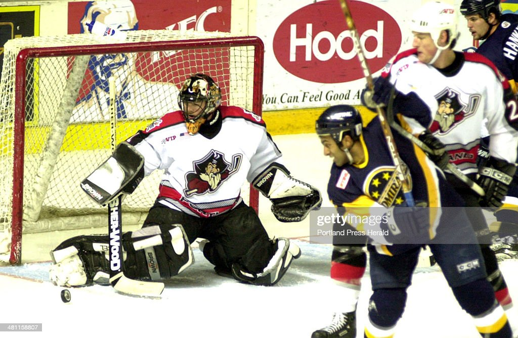 Staff Photo by Herb Swanson Sun Mar 03 2002 Pirate goalie Sebastien Charpentier deflects a shot from a Norfolk Admiral during Sunday's game in...