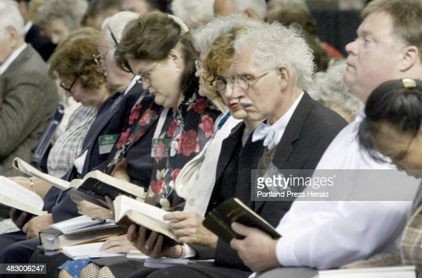 Staff Photo by Herb Swanson Sunday June 20 2004 Jehovah's Witnesses read along with a speaker during their convention at the Cumberland County Civic...