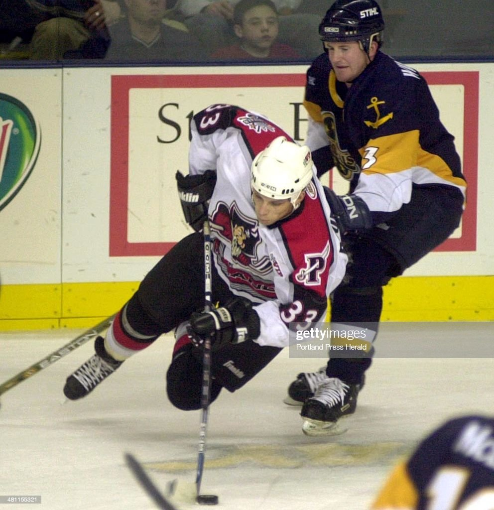 Staff Photo by Herb Swanson Thu Mar 20 2003 Joseph Boumedienne goes after the puck in front ot Norfolk Admiral Marty Wilford in first period action...