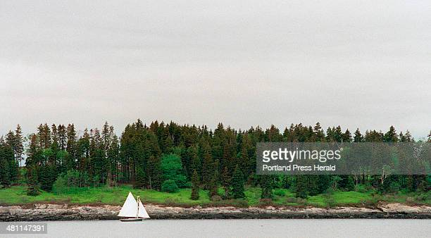 Staff Photo by Herb Swanson Thursday June 22 2000 A Friendship sloop sails along the eastern shore of Hope Island in Casco Bay recently