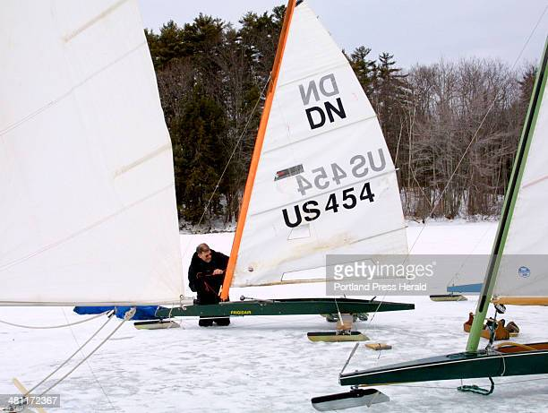 Staff Photo by Herb Swanson Tuesday January 28 2003 Jory Squibb of Camden adjusts the mast on his DN class iceboat before a day sailing on Sebago Lake