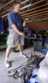 Mark Capano vice president of programs for Special Olympics Maine sorts golf clubs into sets Friday September 15 for an upcoming individual golf...