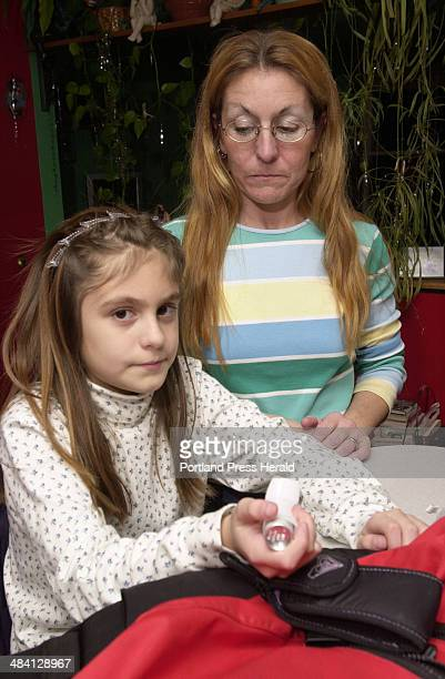 Staff Photo by Jack Milton Thursday January 15 2004 Jeanette Villanueva a fourthgrader at Village School Gorham who has astma carries her Albuterol...