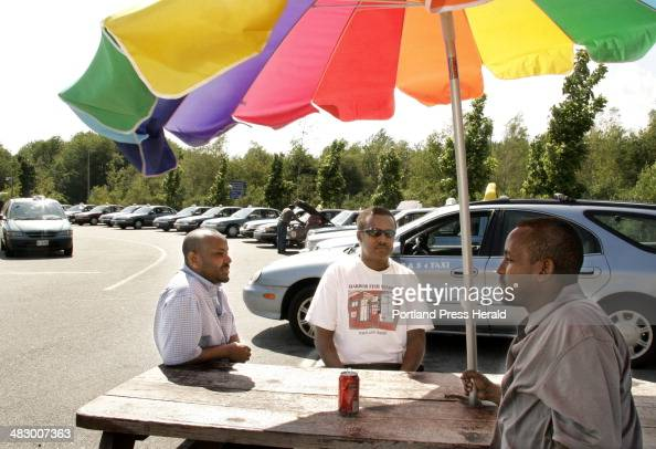 Staff Photo by Jill Brady Friday June 16 2006 Hamza Haadoow Munir Ahmed and Mahad Dhubow wait to give taxi rides at the Portland Jetport *with Kelley...