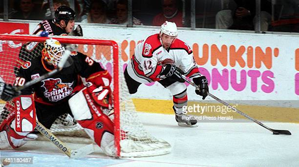 Staff Photo by Jill Brady Sun Apr 15 2001 David Emma of the Portland Pirates is followed by Jason Botterill of the St John Flames as he swings around...