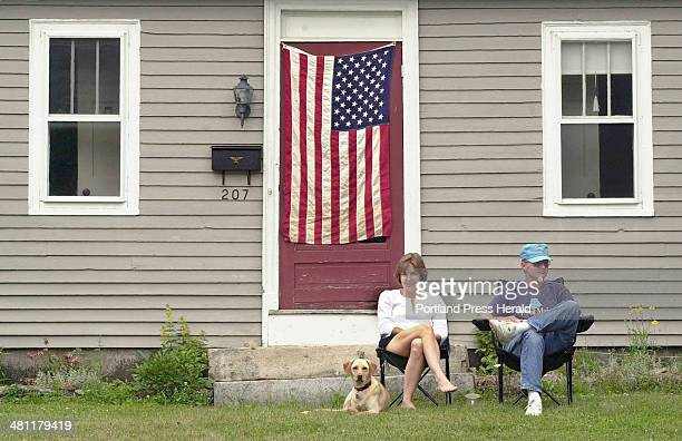 Staff Photo by Jill Brady Wednesday July 4 2001 Candy and Crawford Taisey and their dog Rudder enjoy the view from their lawn on Main Street in...