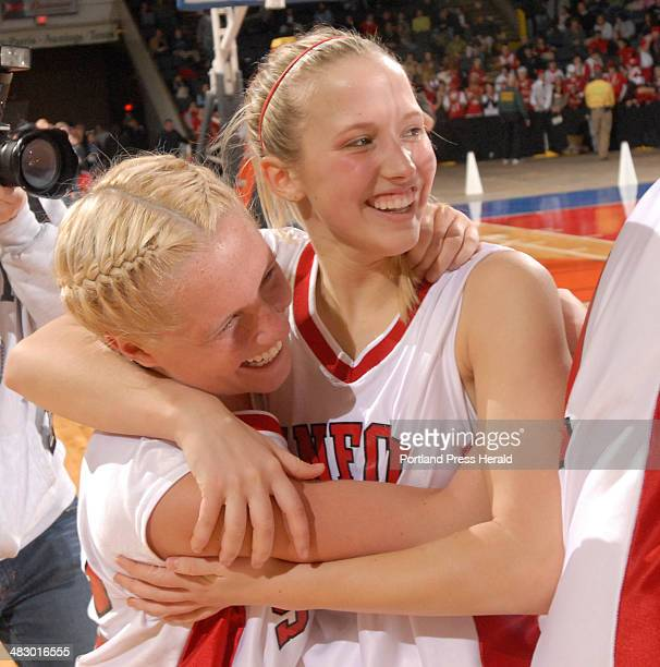 Staff Photo by John Ewing 02/25/06 Colleen Kumka and Samanth Jean relish the moment after defeating South Portland for the western Maine class A...