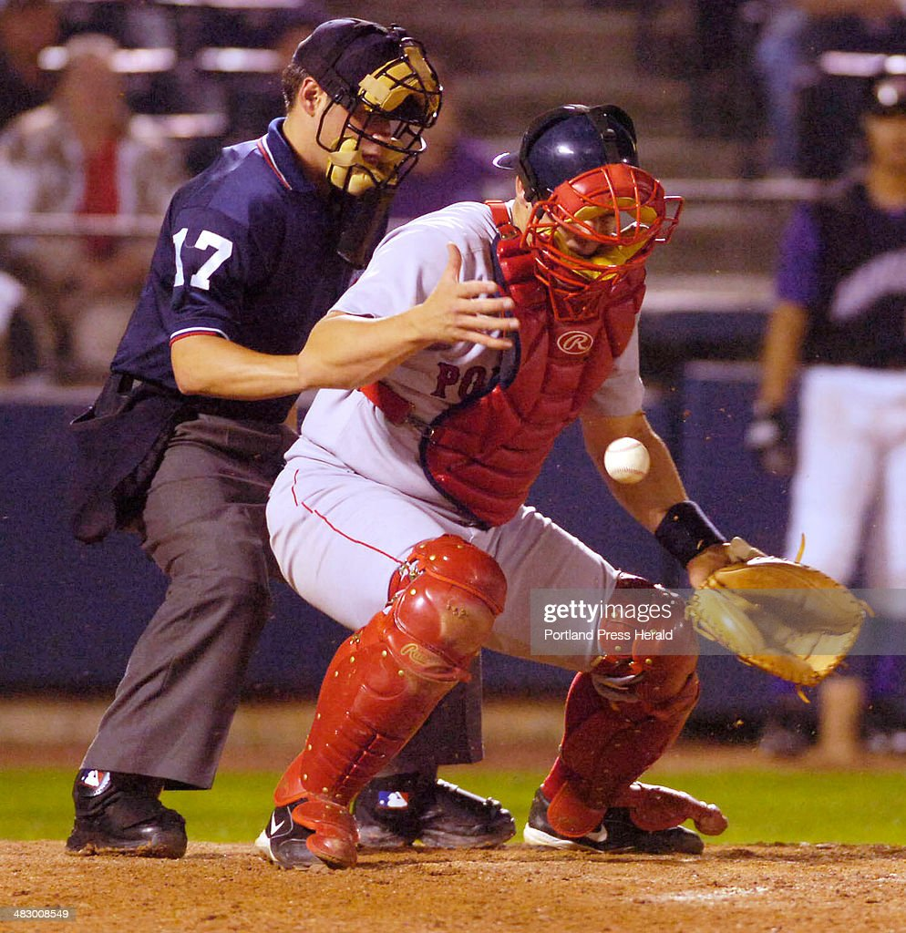 Staff Photo by John Ewing 09/17/05 Catcher Alberto Concepcion blocks a pitch in the dirt of his chest protector