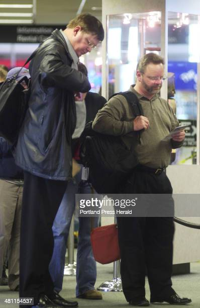 Staff Photo by John Ewing Tue Nov 20 2001 IBM employees Gene Pate and Tony Keller traveling on business await the security checks before boarding...