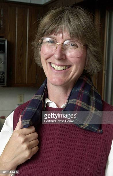 Staff Photo by John Ewing Wed Sep 26 2001 Betsy Hanscom demonstrates how she uses one of her MaineWarmers as a warm collar under her coat on cold...