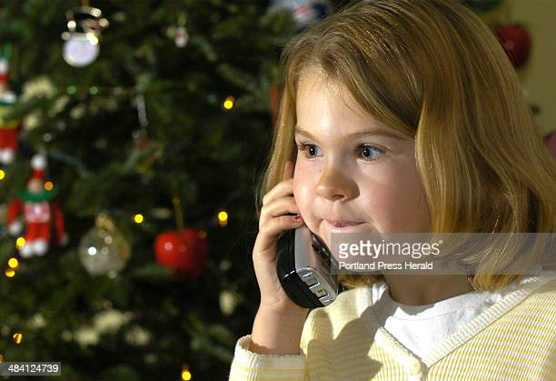 Staff Photo by John Ewing Wednesday December 7 2005 Olivia Sivik has a telephone chat with Santa and some of his elves at her South Portland home on...