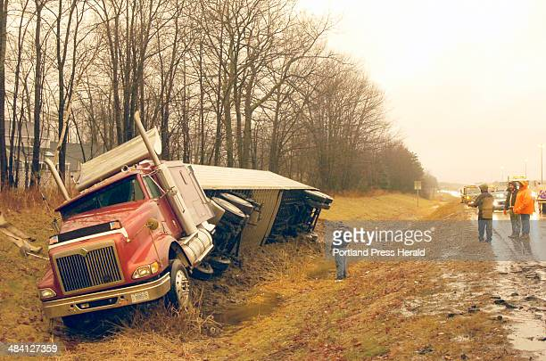 Staff Photo by John Ewing Wednesday January 18 2006 A tractor trailer truck accident on I295 North in South Portland backed up traffic for several...