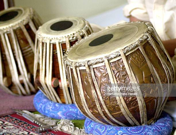 Staff Photo by John Patriquin Friday August 17 2001 This group of copper and goat skin drums are called Tabla and are part of Afghan music culture
