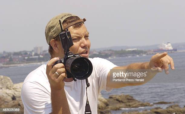 Staff Photo by John Patriquin Thursday June 22 2006 Photographer Richard Sandifer is a commercial photog shown here directing a senior client at Ft...