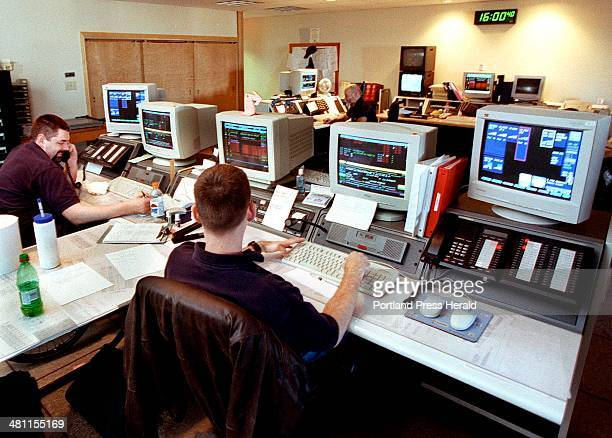 Staff Photo by John Patriquin Tuesday March 21 2000 Portland police dispatchers Brad Williams and James Morrisseau work their shift across the room...