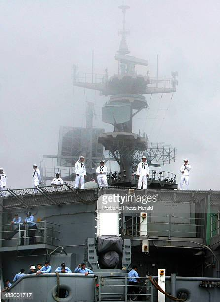 Staff Photo BY Pouya Dianat Saturday July 2 2005 Sailors line the stern of the USS Iwo Jima as it rolls through the morning fog on its way to...
