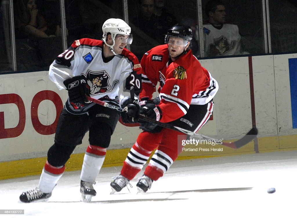 Portland's Curtis Glencross flips the puck to an open teammate as Norfolk's Steve Munn tries to break up the pass Friday Nov 3 2006 in Portland