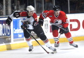 Portland's Pierre Parenteau drives with the puck as Norfolk's Brandon Bochenski moves in on defens Friday Nov 3 2006 in Portland