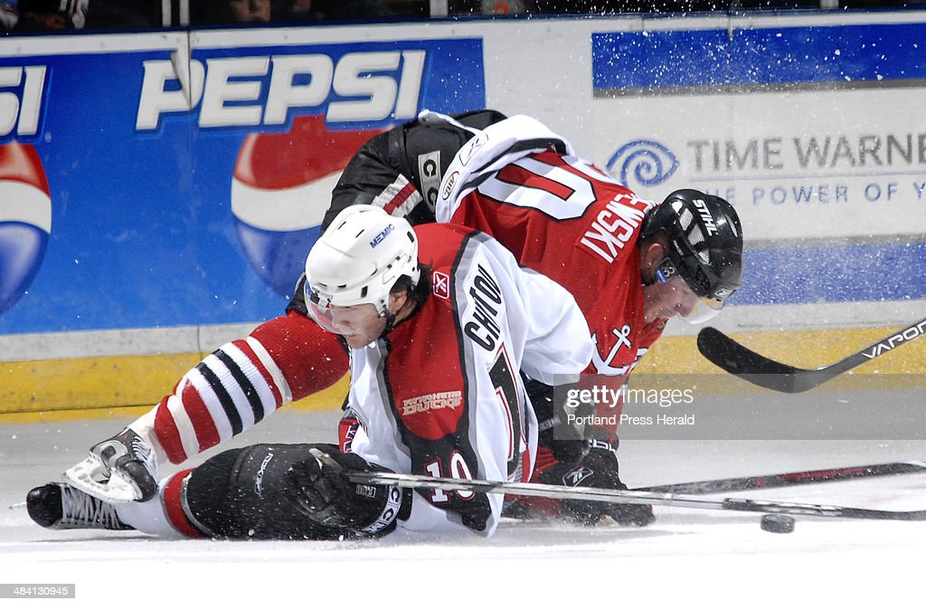 Portland's Stanislav Chistov gets tangled up with Norfolk's James Wisniewski as the two battle for the puck Friday Nov 3 2006 in Portland