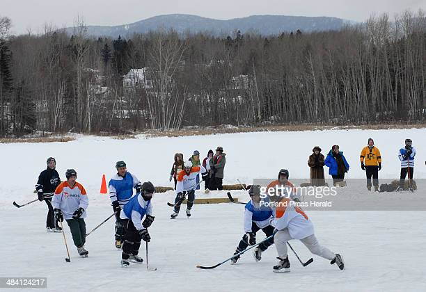 Teams compete on Haley Pond during the The New England Pond Hockey Festival in Rangeley Maine Saturday Feb 9 2007