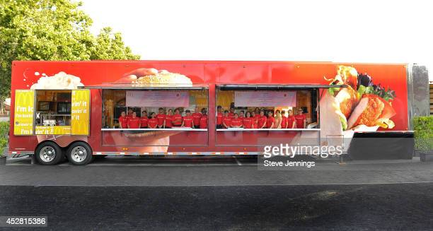 Staff pose in the McDonald's mobile truck for the 2014 BlogHer Conference where attendees will enjoy the newest Happy Meal side choice GoGURT low fat...
