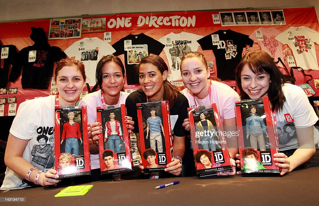Staff pose with merchandise inside the official One Direction merchandise store on April 20, 2012 in Wellington, New Zealand. The 1D fan store will sell official merchandise for four days only, closing on Monday, April 20. One Direction is on tour in New Zealand performing a show in Auckland and Wellington before returning to the UK.