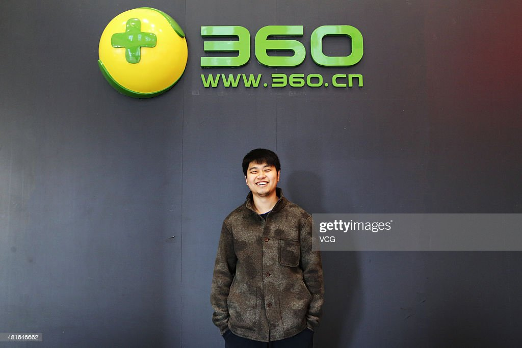A staff poses with logo of Qihoo 360 Technology Co Ltd on March 10 2015 in Beijing China Qihoo 360 Technology Co Ltd is a leading Chinese supplier of...