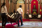 Staff prepare for a meeting between US Secretary of State John Kerry and Vietnam's President Truong Tan Sang at the Presidential Palace in Hanoi on...