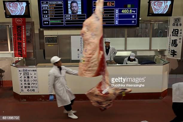 A staff prepares a certified Kobe beef carcass at the Kobe beef auction operated by Kobe Chuo Chikusan Niuke Ltd at the Western Kobe Wholesale market...