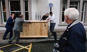 Staff push a mobile bar into location on the morning of the 132nd Durham Miners Gala on July 9 2016 in Durham England More than two decades after the...