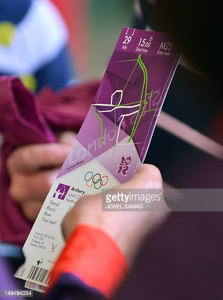 A staff scans a ticket of a spectator arriving to watch the women's team archery event on Day 2 of the London 2012 Olympic Games at Lord's Cricket...
